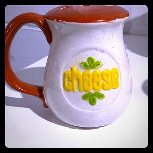 Ceramic cheese shaker with cute saying on bottom